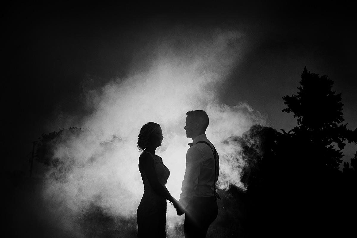 smoke B&W wedding couple bride and groom backlight