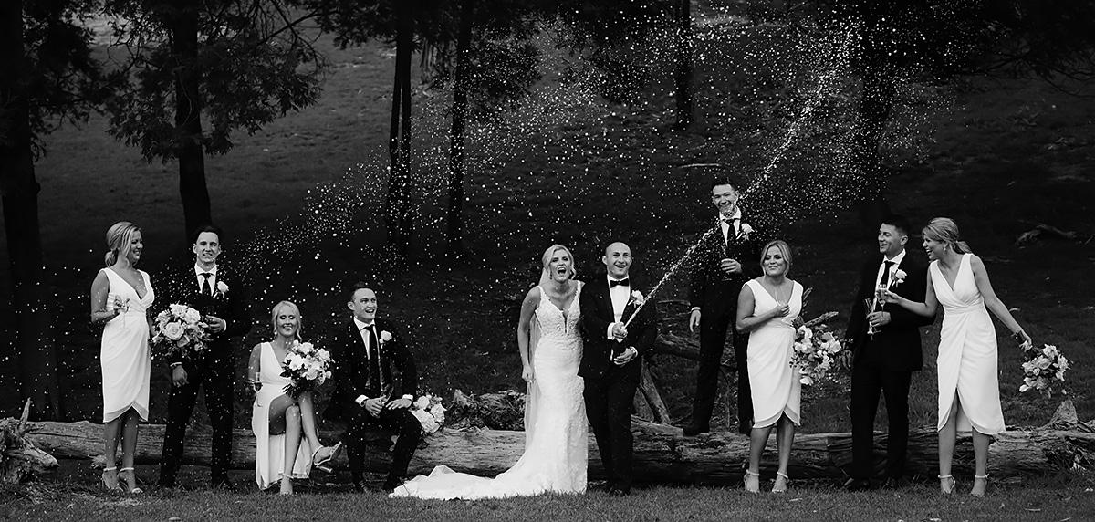 wedding bridal party spraying champagne